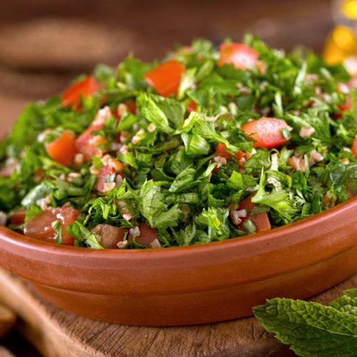 tabouli salad in terracotta bowl